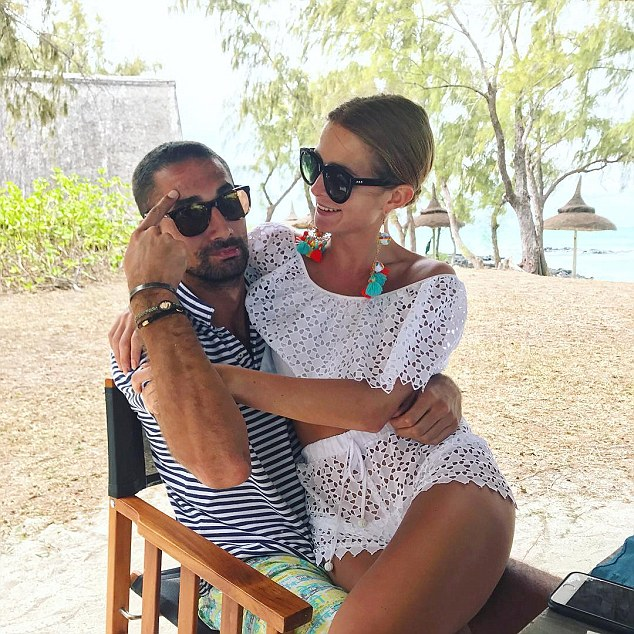 Cute couple:Millie wasn't alone on her travels, and shared a sweet snap cuddled up to her beau Hugo Taylor - who had a sunburnt forehead