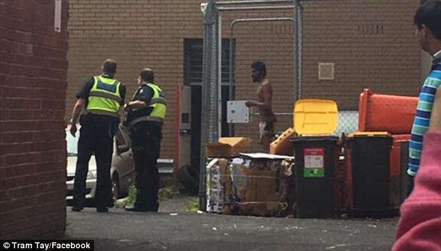 It's alleged that the man (centre) doused himself in accelerant and set himself alight sparking an explosion in the bank