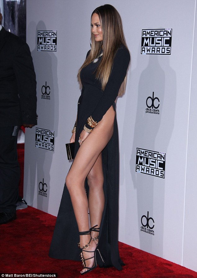 Stunner: The star's long-sleeved black number revealed her sculpted legs, hips and stomach