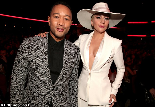 Talented: John stopped to pose for a picture with the equally talented Lady Gaga