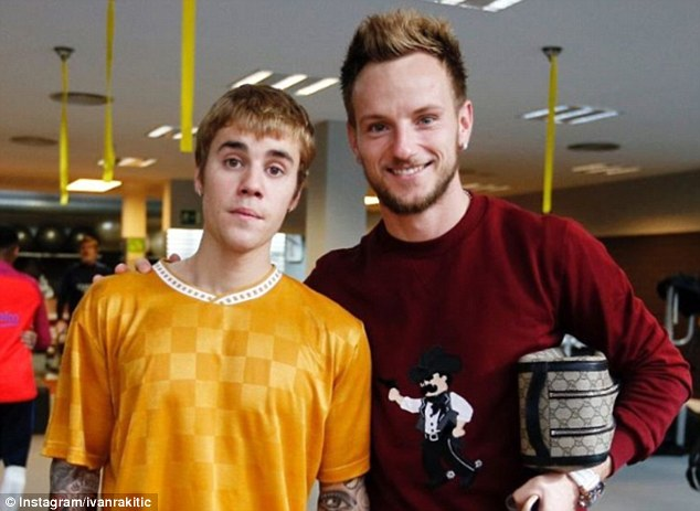 Barcelona's Croatian midfielder Ivan Rakitic poses with the 22-year-old Canadian singer