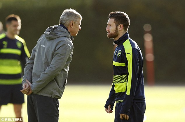 Wenger (left) shares some words of wisdom with defender Shkodran Mustafi (right)