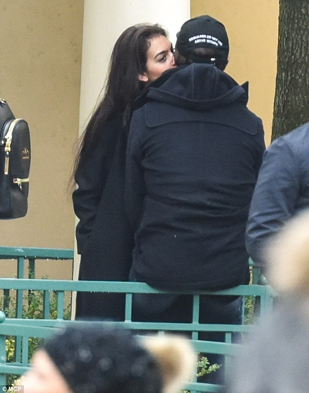 Lip service: Georgina quickly returned the kiss as they took a break in the French capital