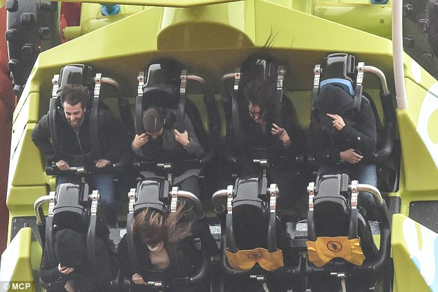 Hold on tight! He was seen pulling his hood over his head as the ride plummeted at speed