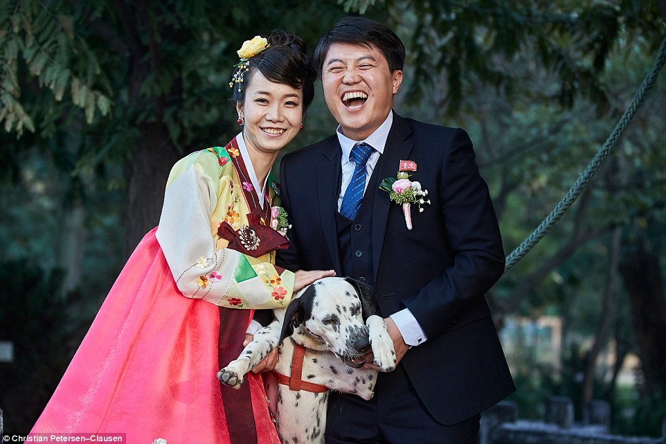 The affluent few reside in the capital Pyongyang and the major growth cities of Chongjin, Wonson and Hamhung. A couple sport colourful international fashions and pose with their pet Dalmation