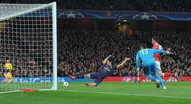 Edinson Cavani slid in to give PSG the lead against Arsenal at the Emirates Stadium, converting Blaise Matuidi's pull back