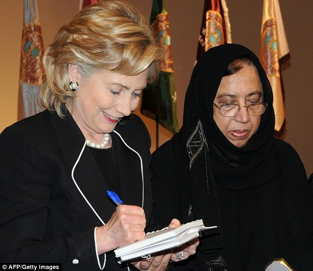 Close family relationship: Both the Abedin sisters and their mom have been photographed with Huma's boss, in their mother's case at the Saudi university where she worked when Clinton was Secretary of State