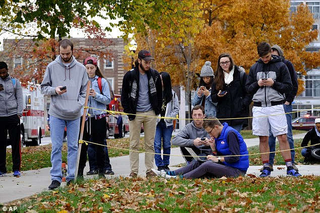 Students gather near the scene of an attack on the campus at Ohio State University on Monday, Nov. 28, 2016, in Columbus, Ohio
