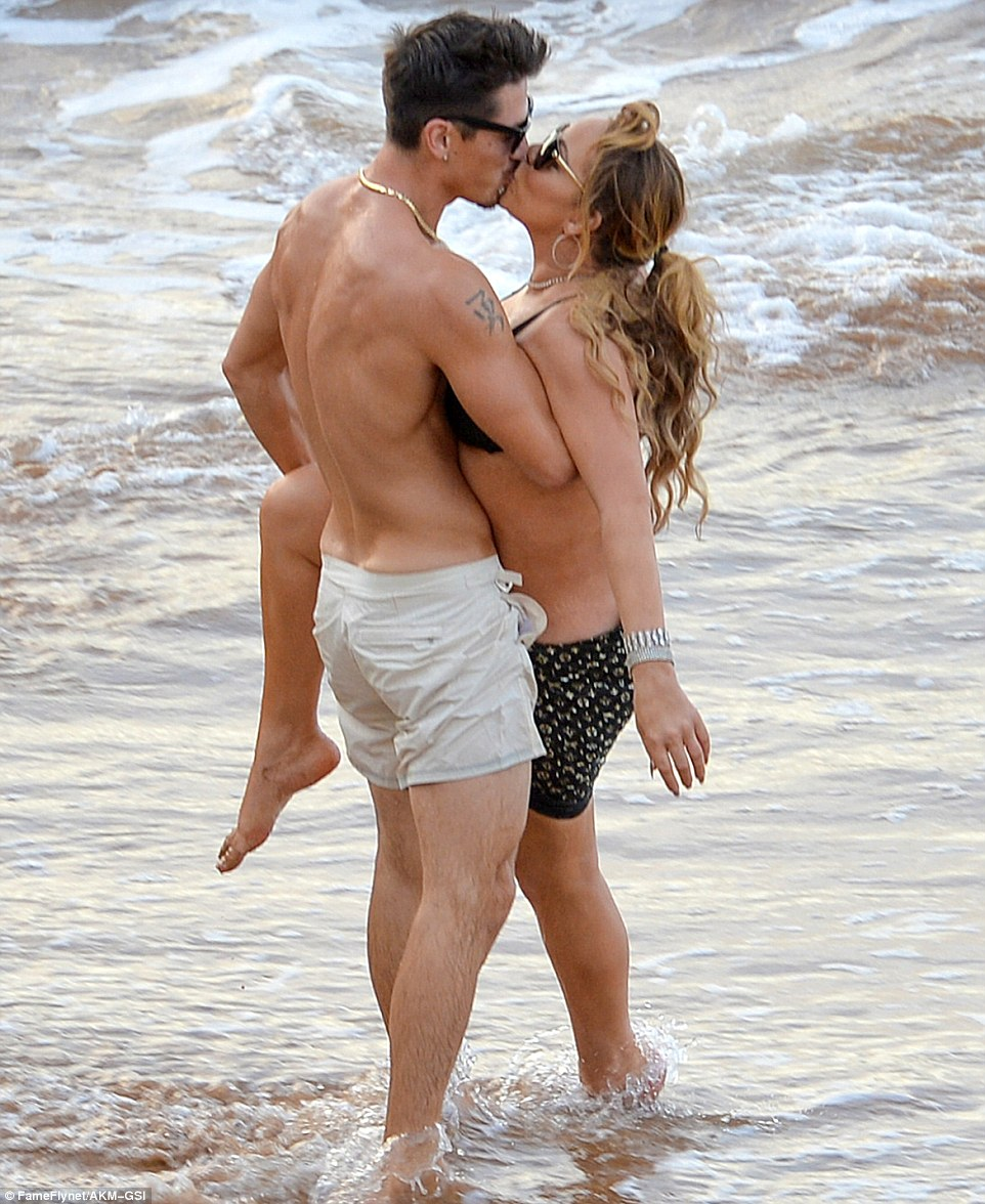All she wants for Christmas is him!: Mariah Carey confirmed her romance withBryan Tanaka with a kiss on Monday