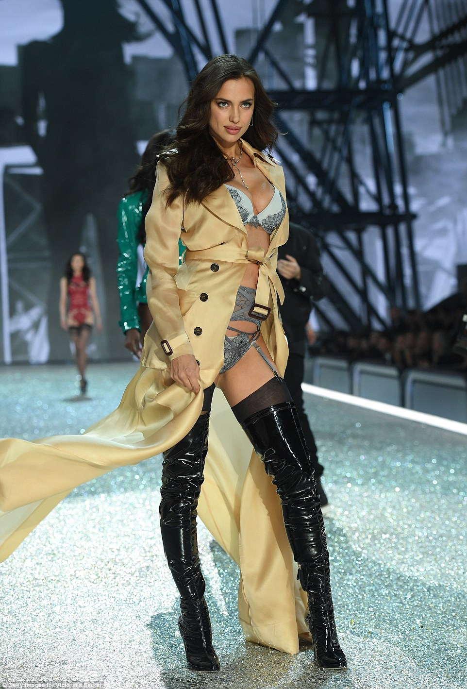 Pout of control: Irina Shayk smouldered in her sexy mac as she made sure all eyes were on her
