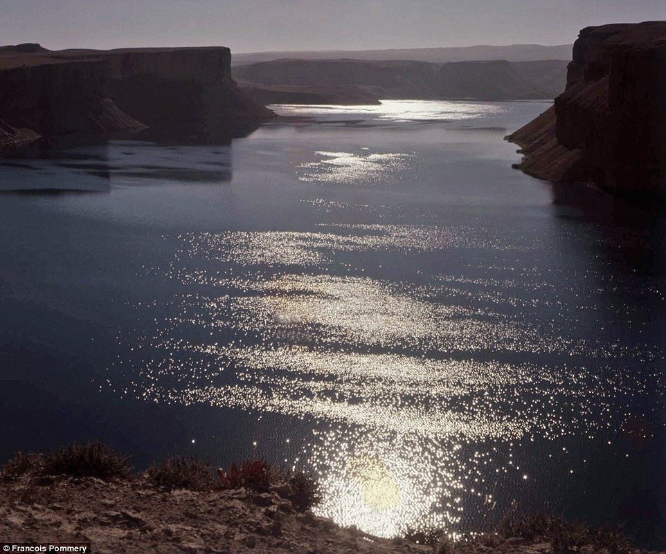 A lake in Band-e Amir National Park glistens in the evening sun