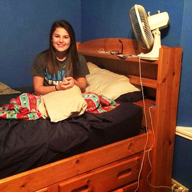 Did the photographer know when they took the photo that there was somebody hiding beneath the bed? Their eyes can be spotted in between the mattress and the bed on the right hand side