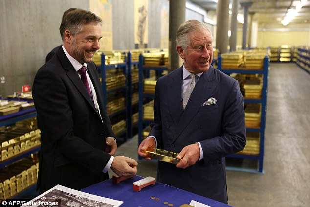 Prince Charles is shown around the gold vaults at the Bank of England. The chambers hold around 400,000 bars of gold worth more than £100 billion