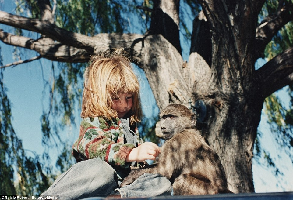 With Cindy the baboon at the age of six in Namibia, Tipi's childhood was an unusual one in which she travelled extensively around Africa