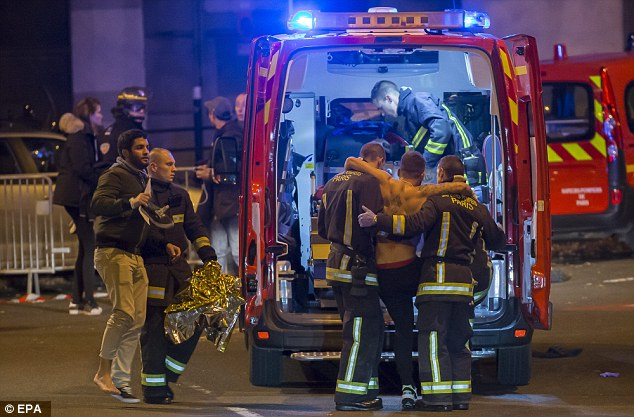 Woundedpeople were evacuated from the Stade de France in Paris after a series of explosions