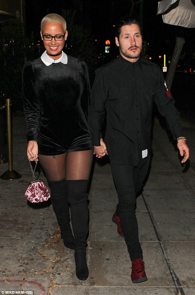 Making it official? Amber Rose and Valentin Chmerkovskiy appear to have confirmed their rumoured romance