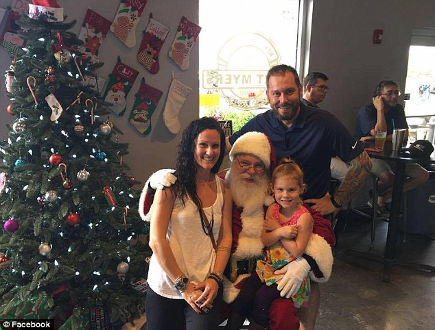 Holly said that when he took his little daughter to see Santa this year, she told him she wanted ammo for Christmas. Holly, his daughter and his wife pictured above with Santa