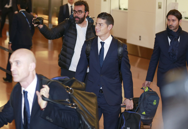 Real Madrid's James Rodriguez greets fans upon his arrival at Haneda International Airport in Tokyo, Monday, Dec. 12, 2016. Real Madrid are flying to Japan t...