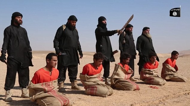 Mohammed Reza Haque (second right) moments before he beheads his victim in a new video