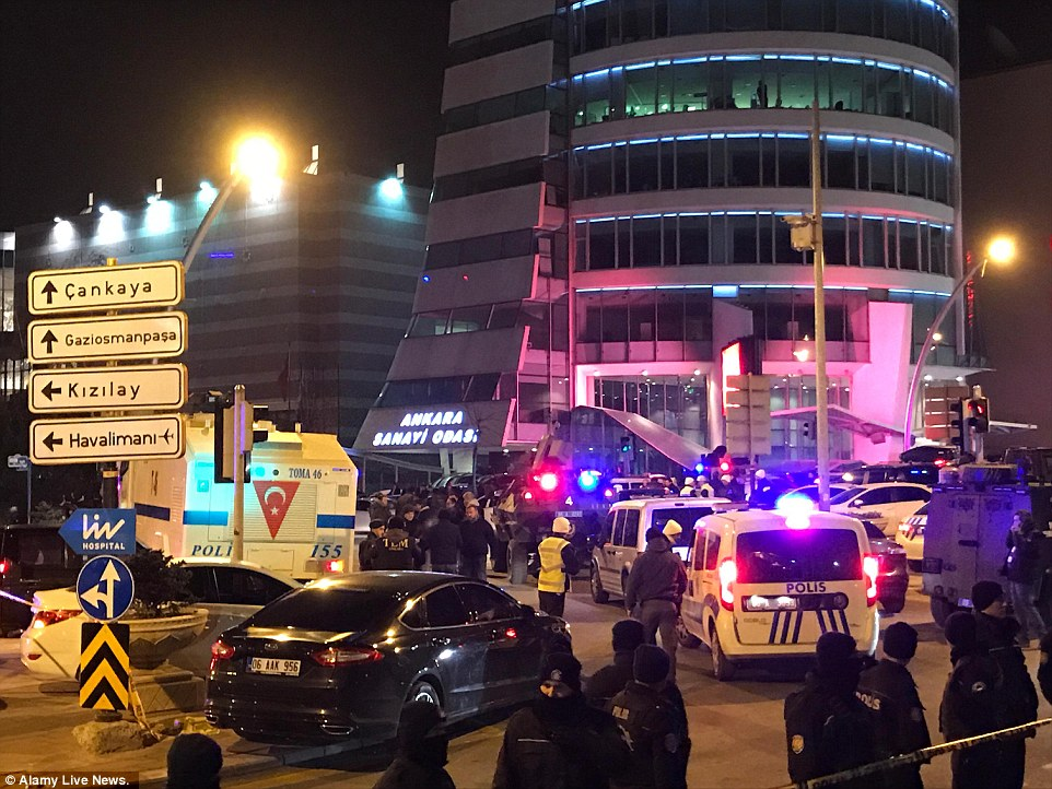 Armed police gathered outside the art centre in Ankara after the fatal shooting of Mr Karlov