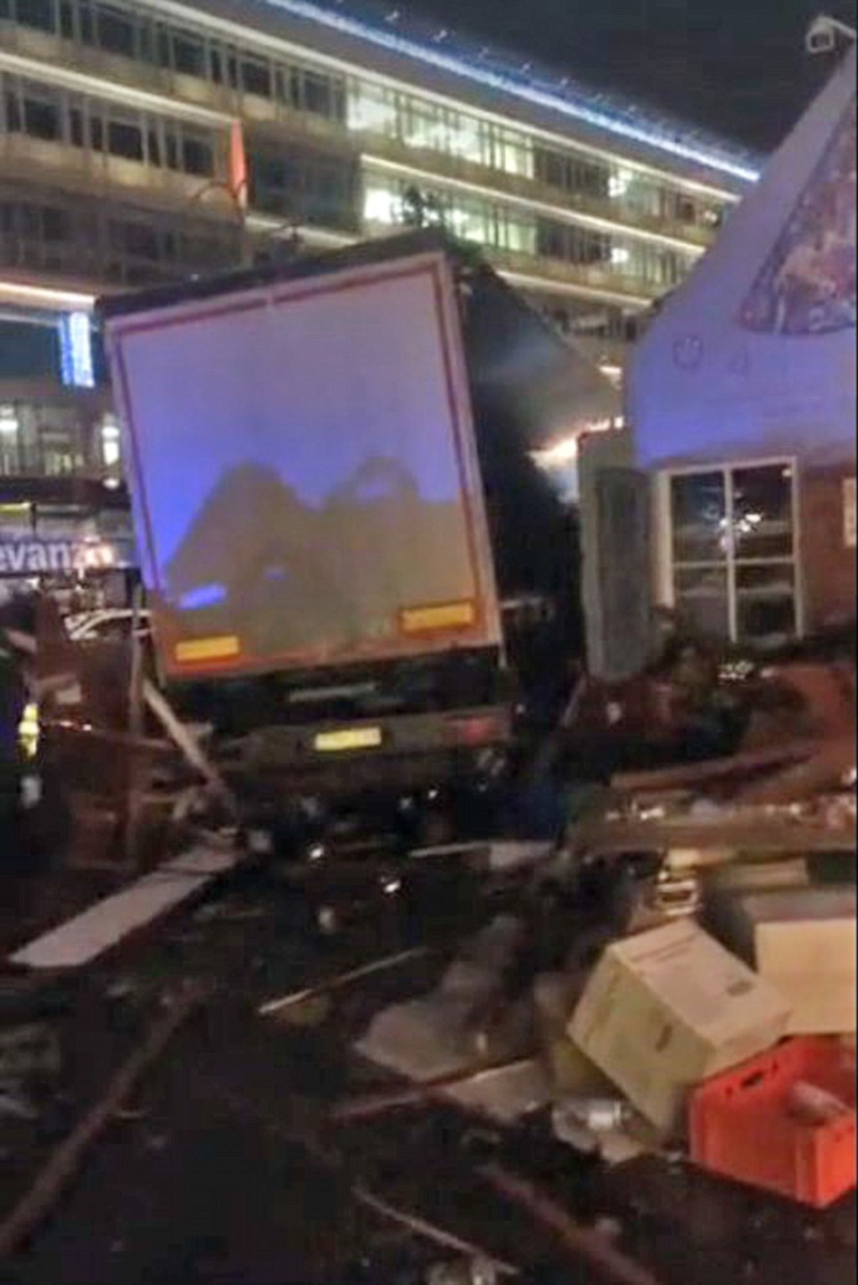 More shoppers were thought to be have been trapped beneath the vehicle (pictured) as it crashed through stalls