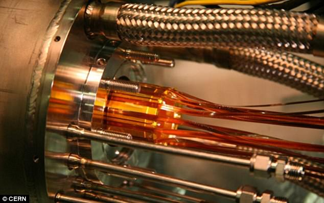 Scientists used a laser to tickle atoms of antimatter and make them shine, a key step toward answering one of the great riddles of the universe. The used theALPHA experiment (pictured) at CERN , which is located on the Swiss-French border.