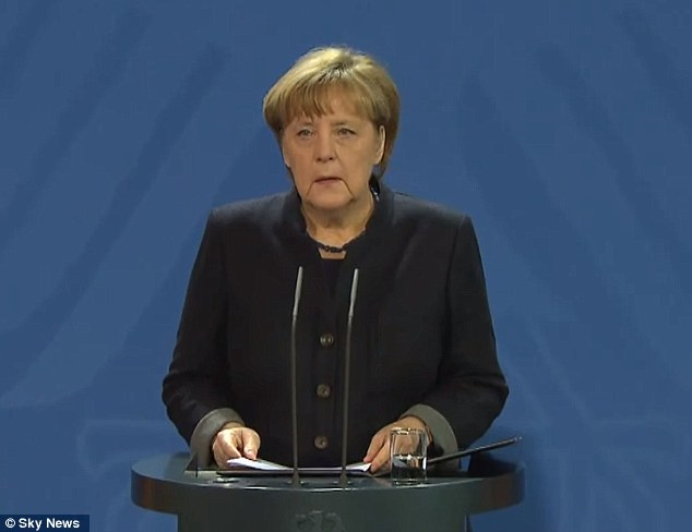 German chancellor Merkel (pictured giving a statement this morning) has come under huge political pressure for allowing nearly a million people fleeing conflict and poverty in the Middle East and Africa to arrive in the country this year and last
