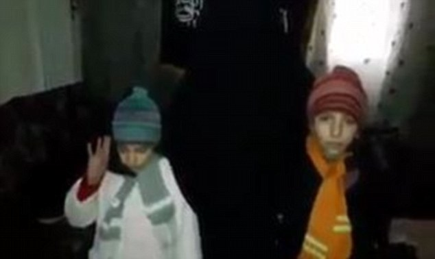 Both girls say 'Allahu Akbar' before separate footage shows them dressed in coats and woolly hats as they embrace their mother and leave the room