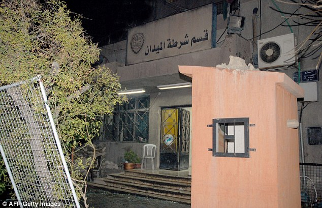 The seven-year-old is thought to have walked into a police station (pictured) in Syria's capital, Damascus, before being killed in an explosion believed to have been detonated remotely