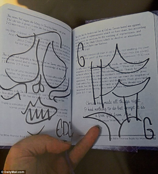 Sanders even took Icie's best friend Jordan Hammer's bible andscrawled the number 666 - the mark of the devil - as well as several other drawings over several pages