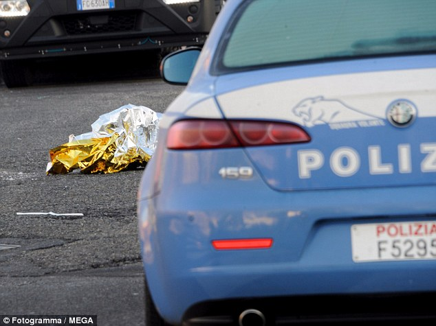 At dawn forensics officers removed the body and began photographing bullets strewn across the ground from the shoot-out. There were also blood-soaked clothes and tissues