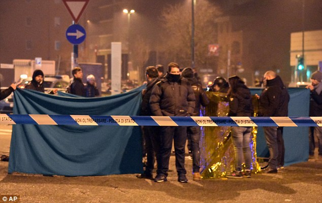 Italian police cordon off an area around the body of Anis Amri after a shoot-out with police