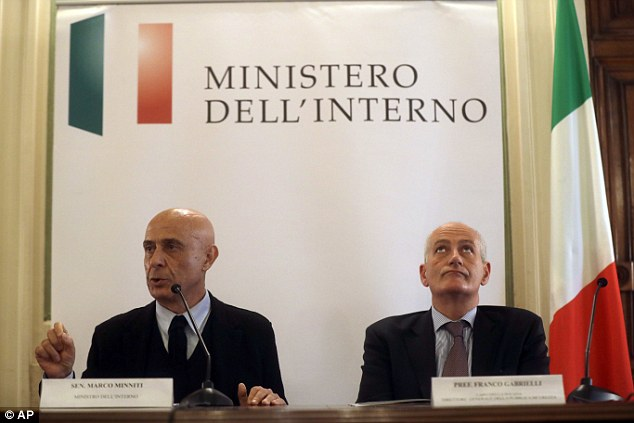 Italian Interior Minister Marco Minniti, left, is flanked by Rome's prefect Franco Gabrielli as he speaks during a news conference in Rome