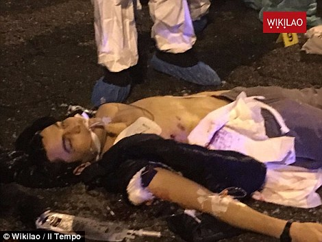 Pictures emerged this morning of the terrorist lying dead in the street having been shot by Italian police
