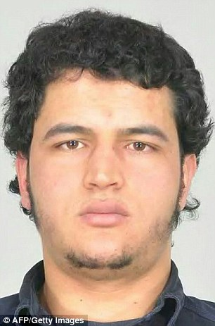 Amri (pictured) shouted 'Allahu Akbar' and 'police b******s' as he shot at police officers in Milan