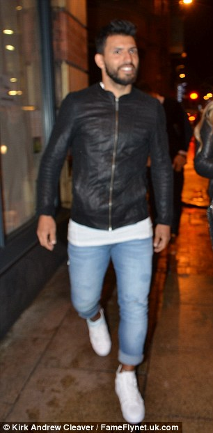 Suspended striker Sergio Aguero donned his leather jacket for the night