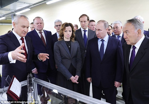 General director at the Diakont Group of Companies, Nikolai Tsukanov (left), explains the plant's process to Kazakhstan's President Nursultan Nazarbayev (right) and Russia's President Vladimir Putin (centre)