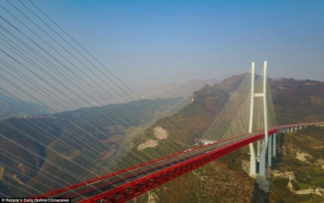 What a view! The enormous mountain overpass standing at a whopping 565 metres high (1,854 feet) opened to traffic today