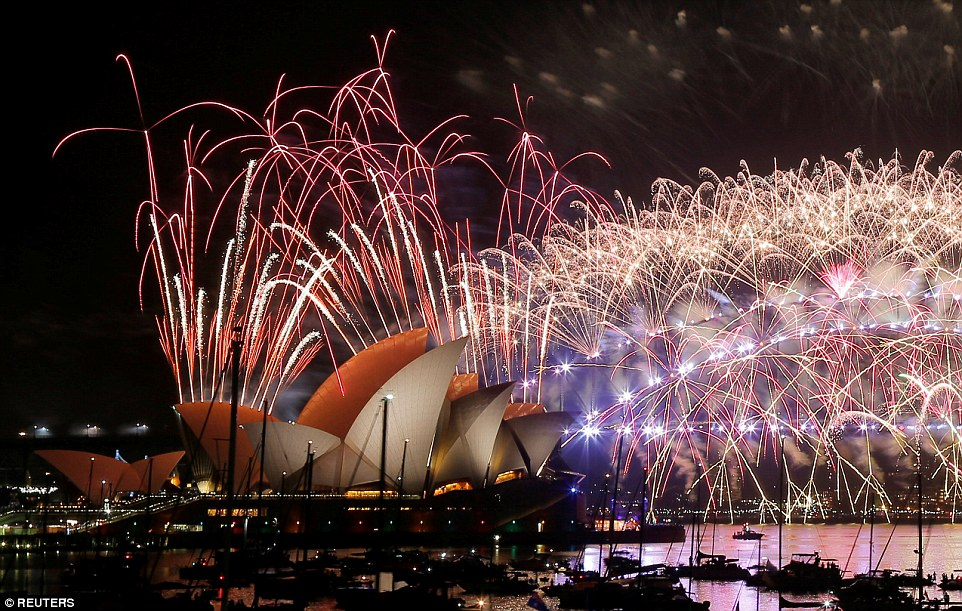 Fireworks explode over the Sydney Opera House and Harbour Bridge as Australia ushers in the New Year in Sydney