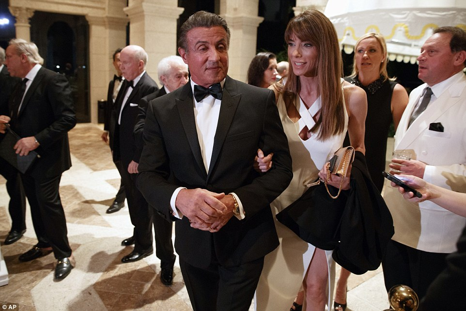 Sylvester Stallone, left, and his wife Jennifer Flavin arrive for a New Year's Eve party at Mar-a-Lago