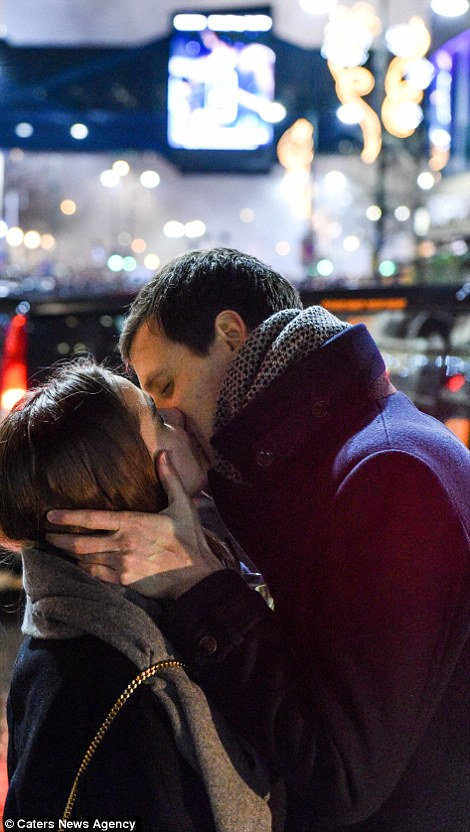 A couple share a New Year's kiss