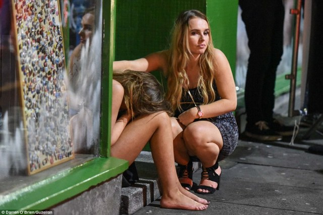 A woman attends to her friend in Sheffield as the drunken celebrations left many worse for wear