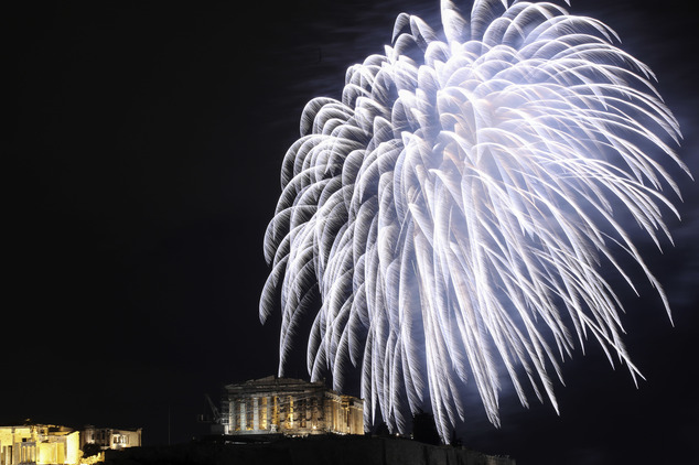Fireworks explode over the temple of the Parthenon at the Acropolis hill during the New Year celebrations in Athens, Sunday, Jan. 1, 2017. (AP Photo/Yorgos K...
