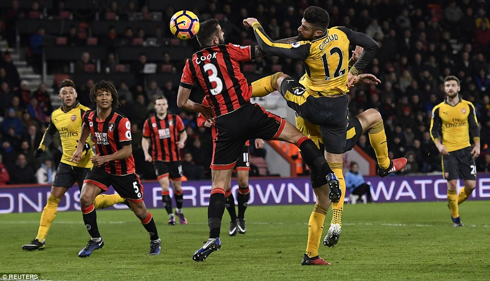 Giroud pictured as he scores against Bournemouth in stoppage time to see Arsenal come back from three goals down