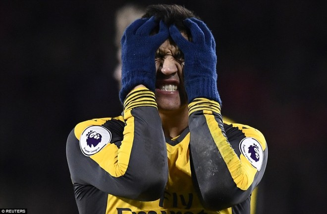 Sanchez pictured reacting during the match as Arsenal eventually went 3-0 down against Bournemouth