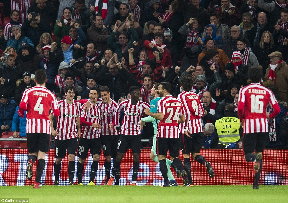 Aduriz is joined by his team-mates as they celebrate in front of jubilant home supporters during their Copa del Rey clash