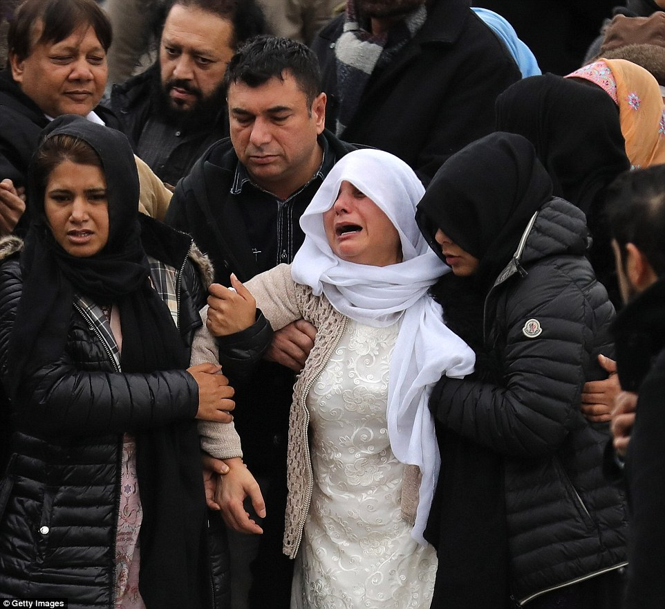 Bereft: Yassar's grieving mother Safia (centre) had to be held up by loved-ones as she left the funeral with husband Mohammed (top left of picture)