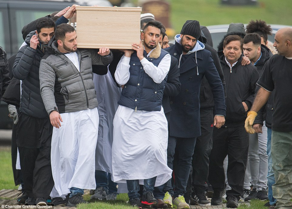 Funeral: Family including Yassar's father Mohammed (second right with hands in pockets) follow the 28-year-old's coffin to its final resting place