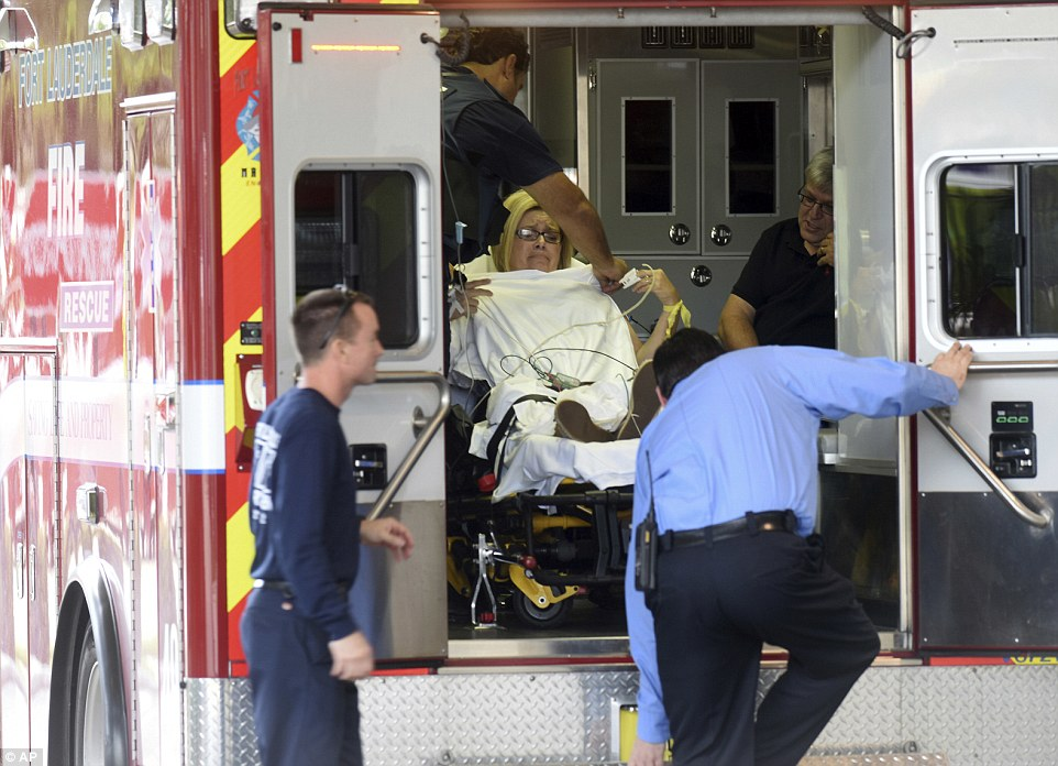 A shooting victim is seen in the back of an ambulance after arriving at the Broward Health Trauma Center on Friday