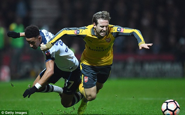 Nacho Monreal of Arsenal tangles with Callum Robinson of Preston